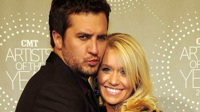 Luke Bryan and woman posing for a picture