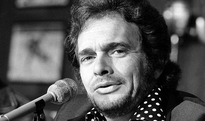 Merle Haggard with a microphone