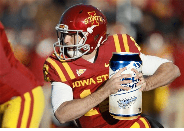 A football player holding a can