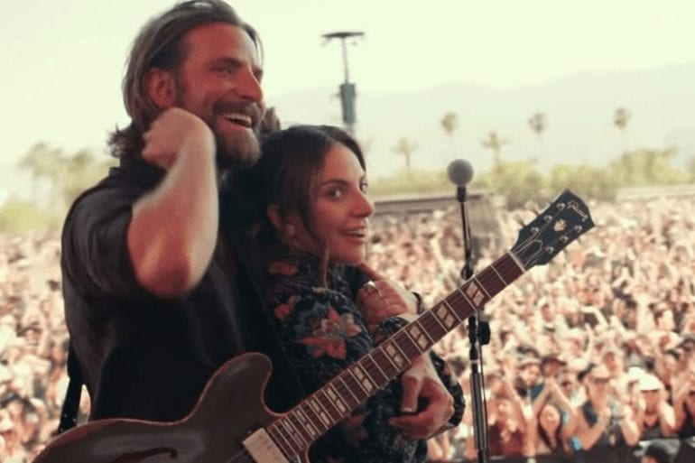 A man and a woman playing guitar