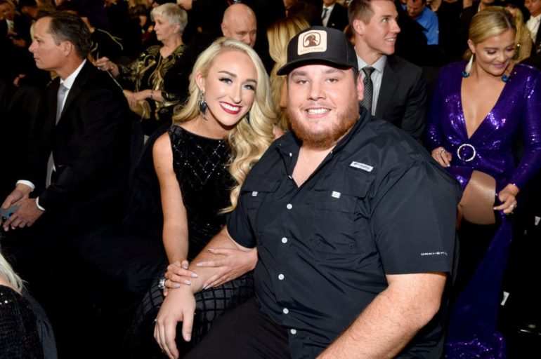 Luke Combs and woman posing for a picture