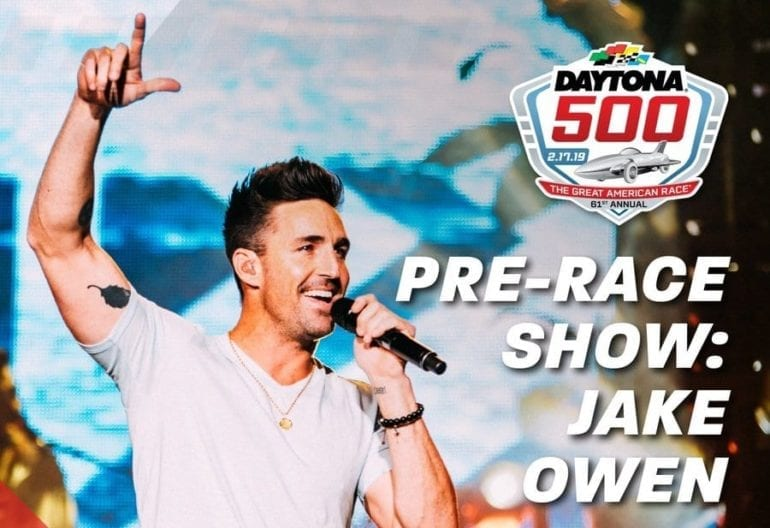 Jake Owen holding a microphone and pointing