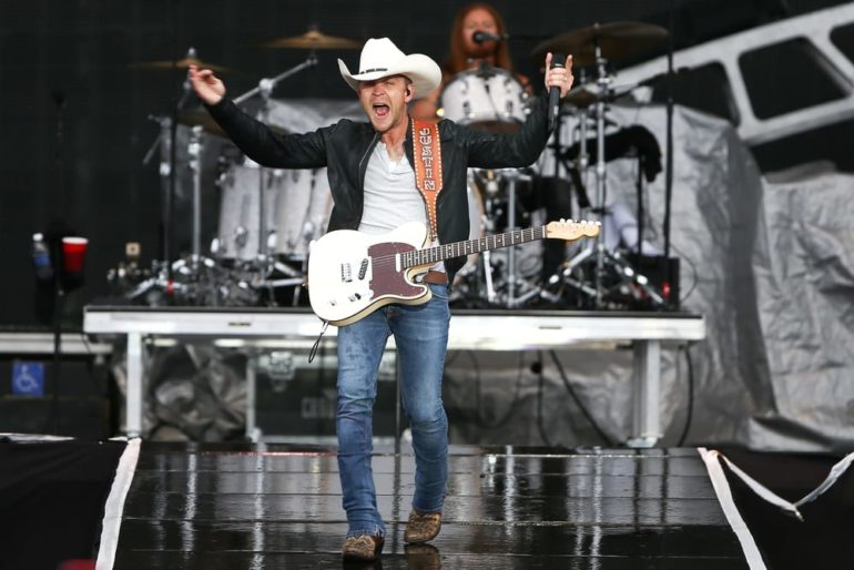 Justin Moore holding a guitar