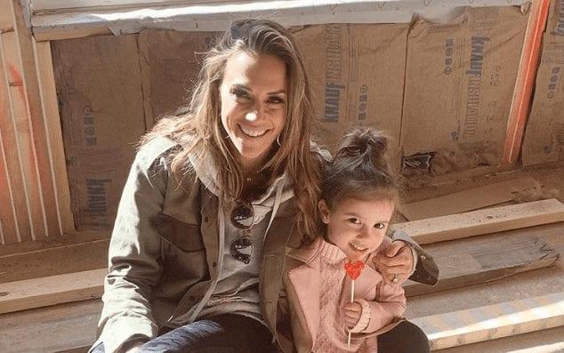 Jana Kramer holding a baby