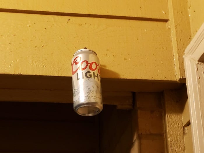 A can of soda on a shelf