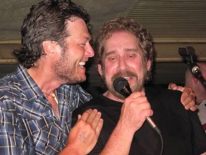 Earl Thomas Conley with a beard and a microphone in front of him