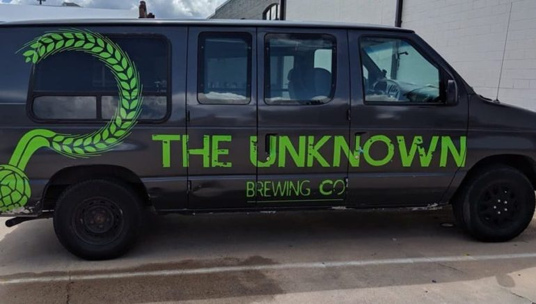 A van with a green sign