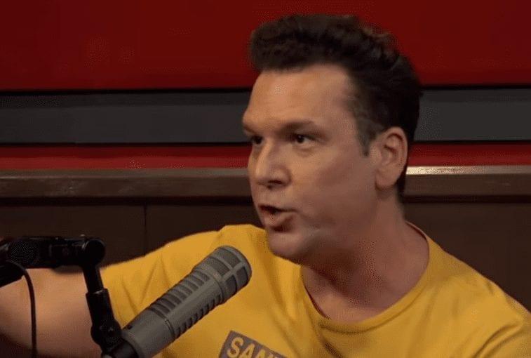 Dane Cook wearing a yellow shirt