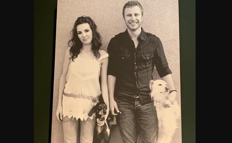 Dierks Bentley and woman holding a couple of dogs