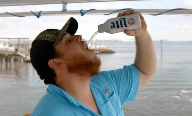 A person drinking from a bottle