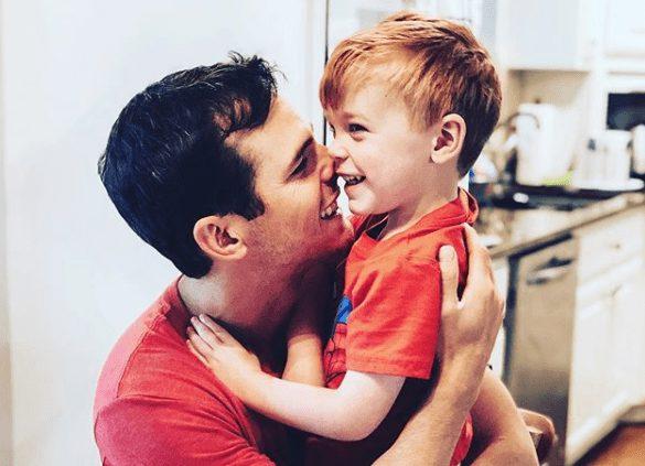 A person kissing a boy