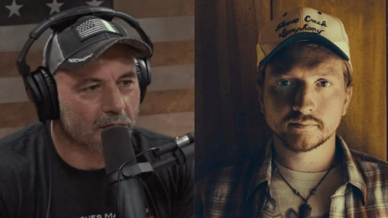 Joe Rogan wearing a helmet and a man with a microphone in front of him