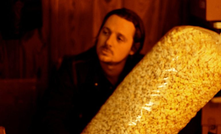 Sturgill Simpson holding a large bag