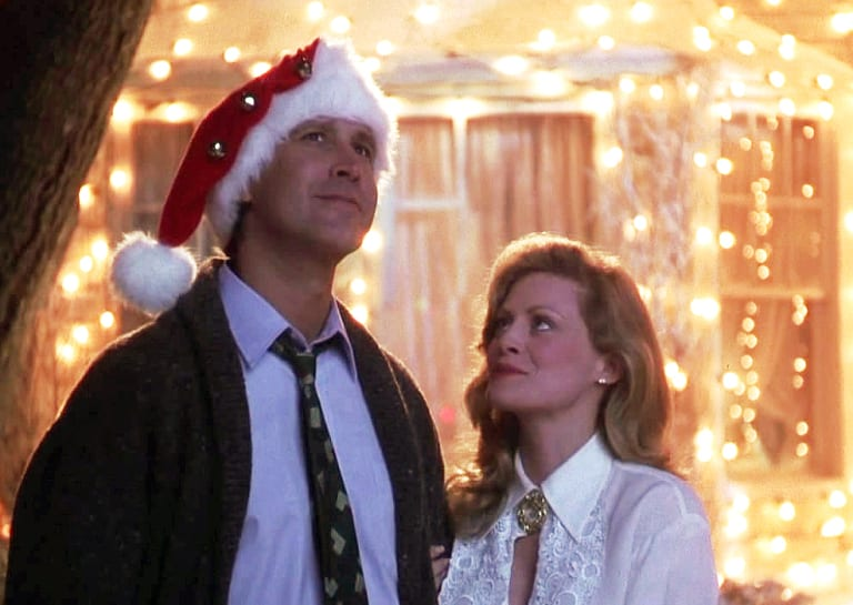 Chevy Chase, Beverly D'Angelo wearing clothing