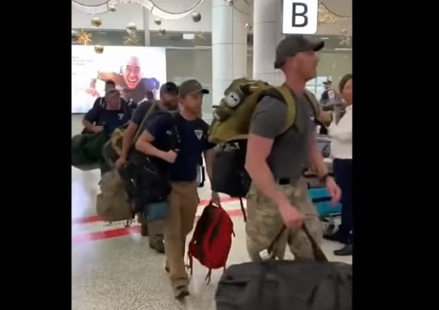 A group of people with luggage