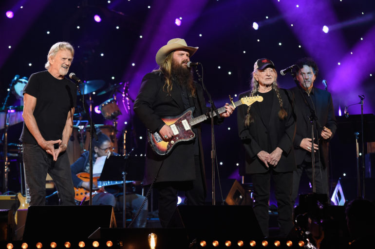 Willie Nelson, Chris Stapleton, Mickey Raphael, Kris Kristofferson are posing for a picture