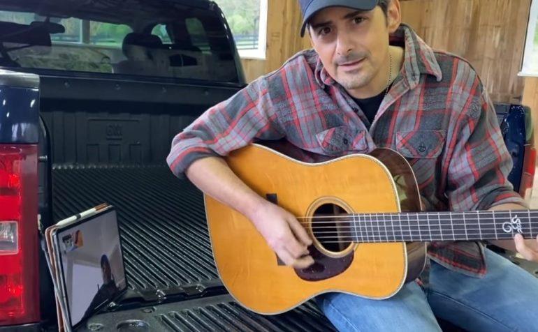 Brad Paisley playing a guitar