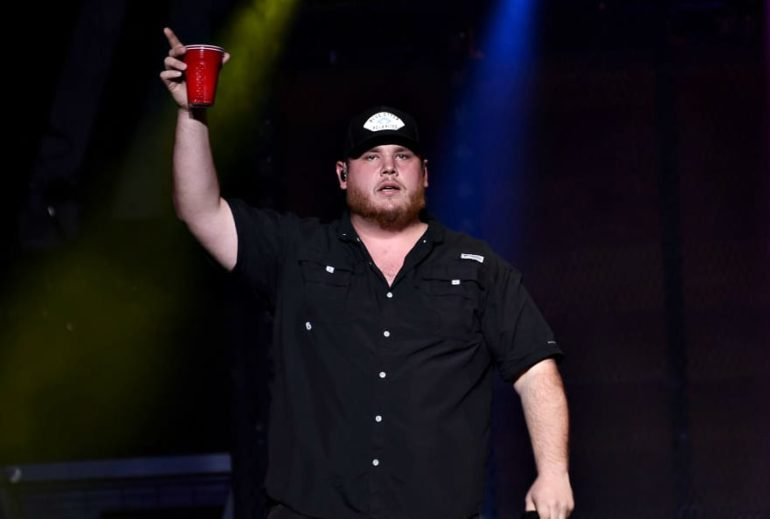 Luke Combs holding a red cup