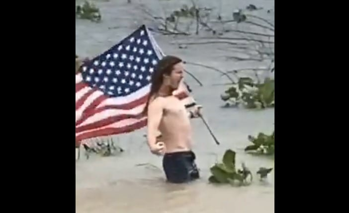 A person holding a flag