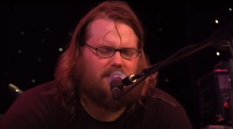 Chris Stapleton singing into a microphone