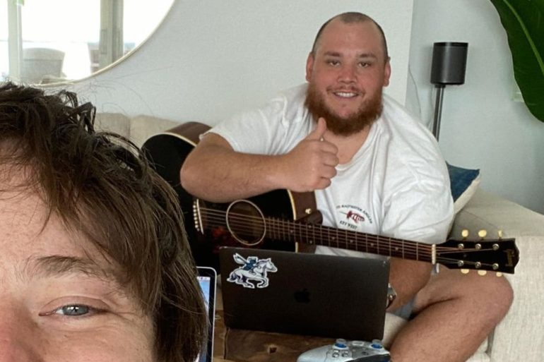 Luke Combs playing a guitar next to a woman holding a guitar