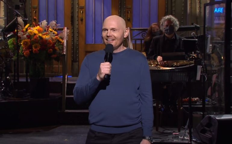 Bill Burr speaking into a microphone
