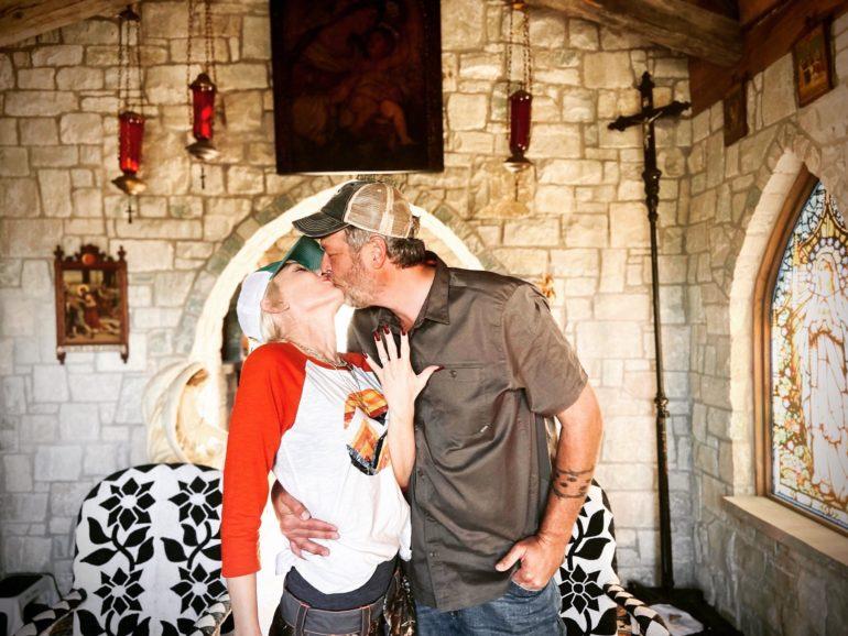 A man kissing a woman on the cheek