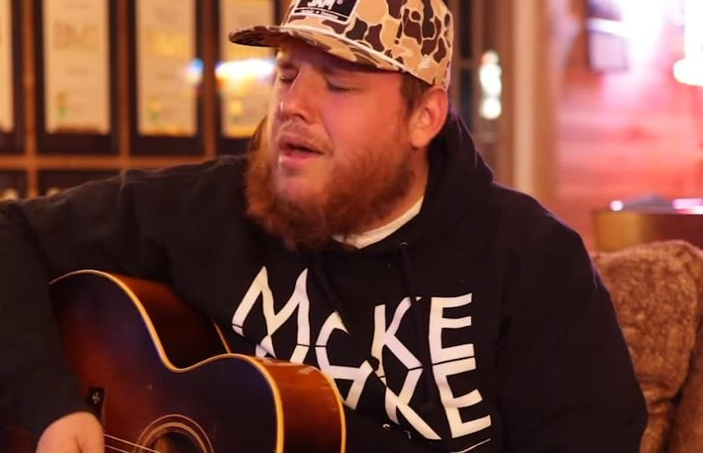 Luke Combs playing a guitar