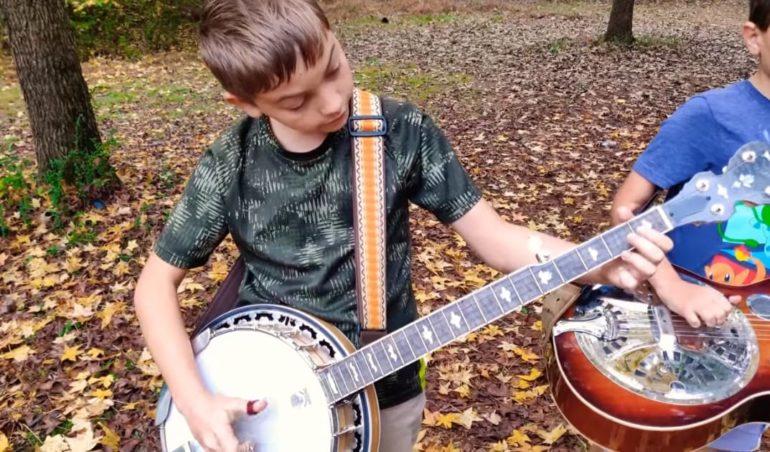 A boy playing a guitar