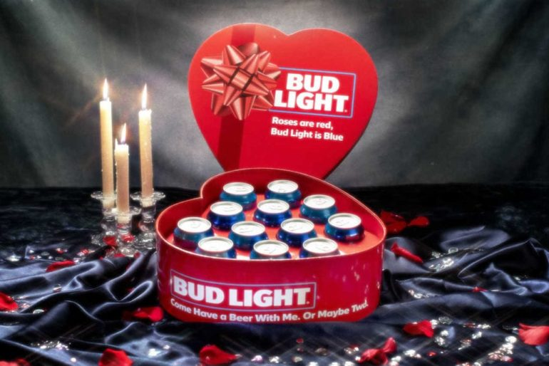 A red and white box with candles and a red heart on a black background