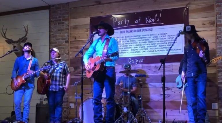 Evan Felker Performing On Stage In Texas