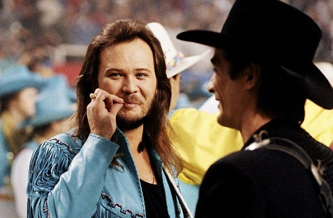 Travis Tritt talking on a cell phone