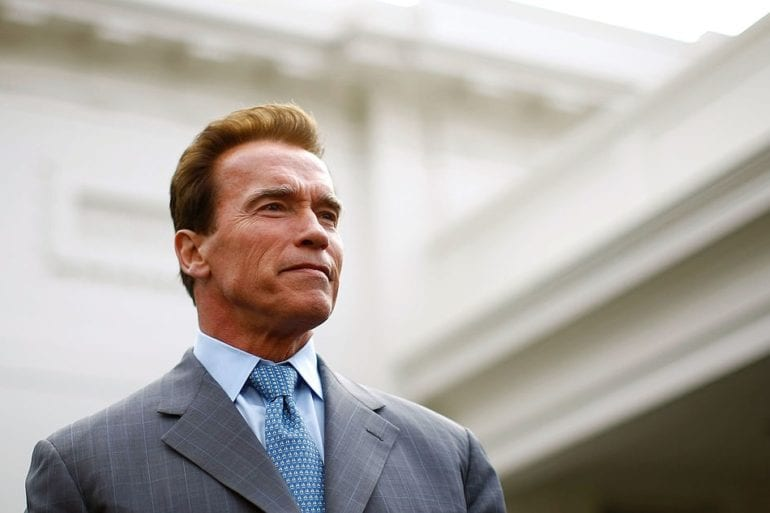 Arnold Schwarzenegger in a suit and tie