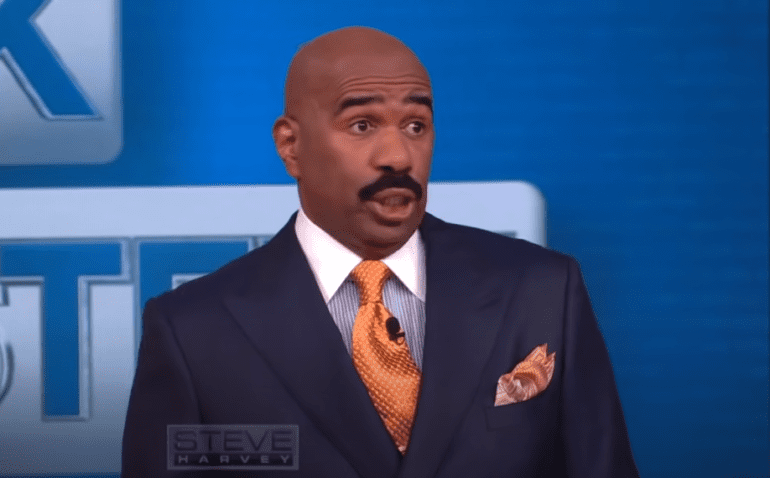 Steve Harvey in a suit and tie