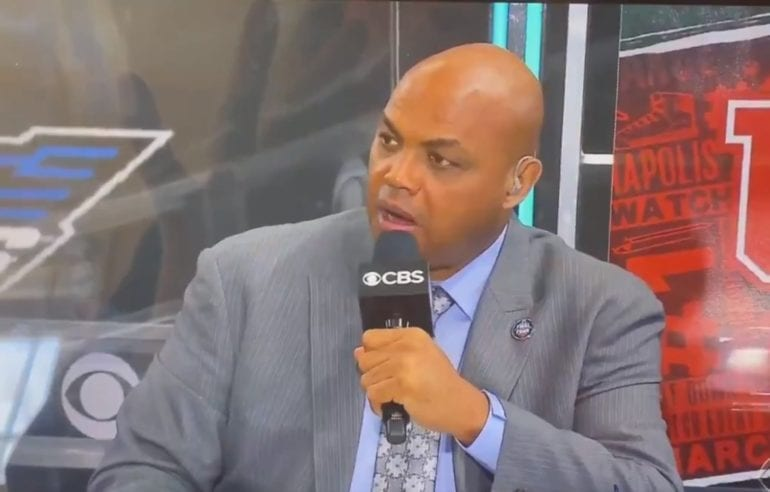 Charles Barkley holding a microphone