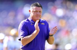 Ed Orgeron with his hands up