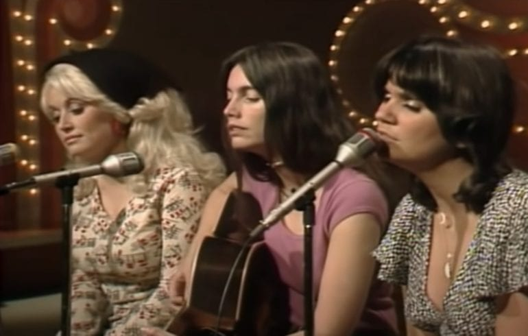A group of women singing into a microphone