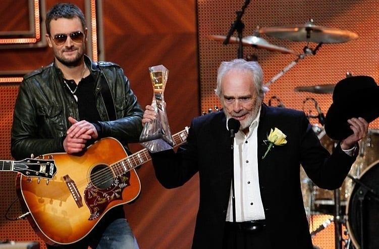 Merle Haggard, Eric Church are posing for a picture