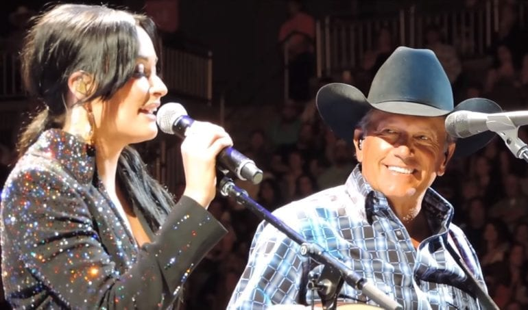 A man and a woman singing into microphones
