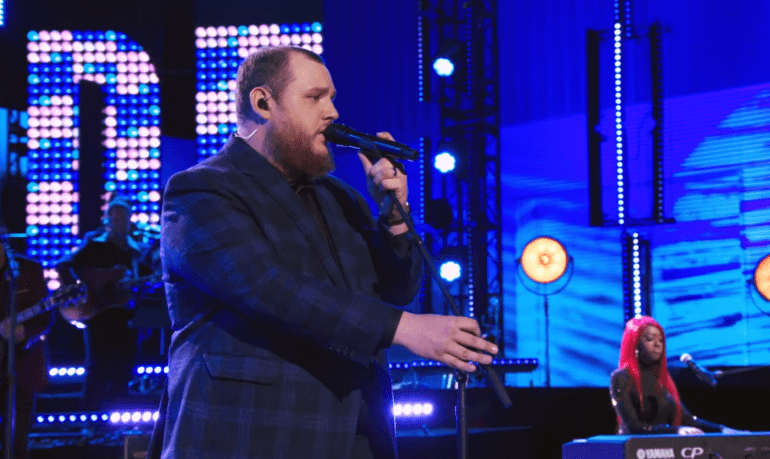 A man singing into a microphone