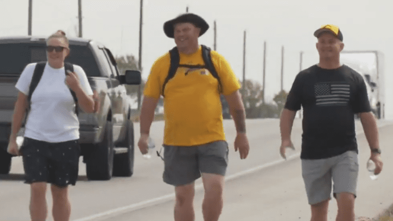 A group of men walking on a road
