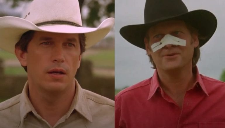 George Strait wearing a hat and a red shirt with a white mask on his face