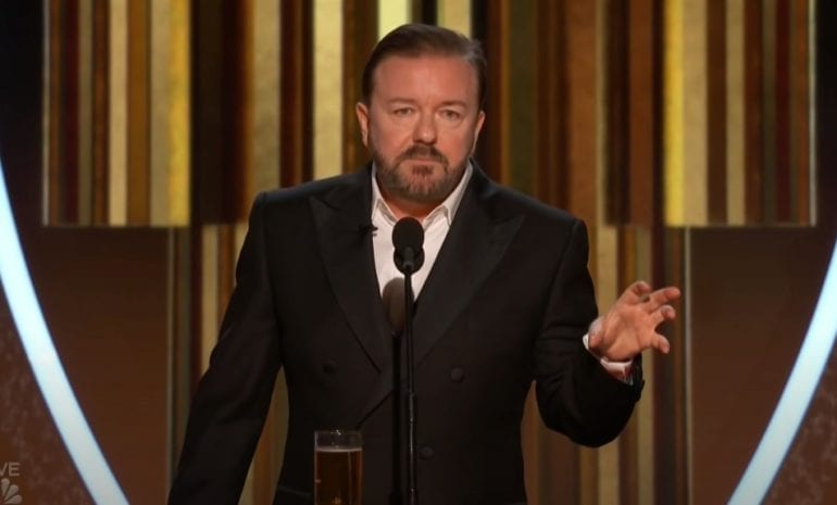 Ricky Gervais in a suit and tie