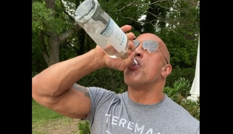 A man drinking from a bottle