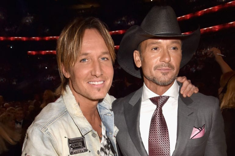 Keith Urban, Tim McGraw are posing for a picture