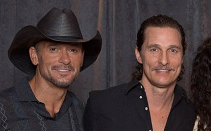 Matthew McConaughey, Tim McGraw are posing for a picture